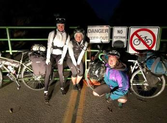 Bike queens don't get stopped by a landslide